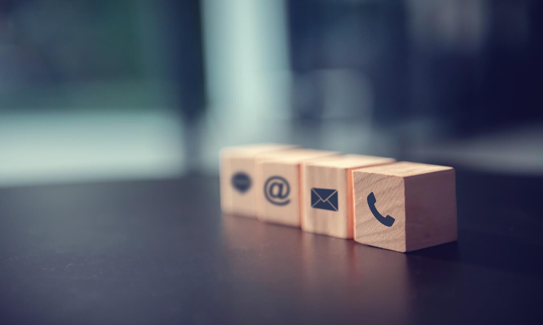 contact-us-concept-wood-block-symbol-telephone-mail-address-desk
