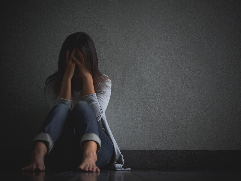 sad-woman-hug-her-knee-cry-sitting-alone-empty-room