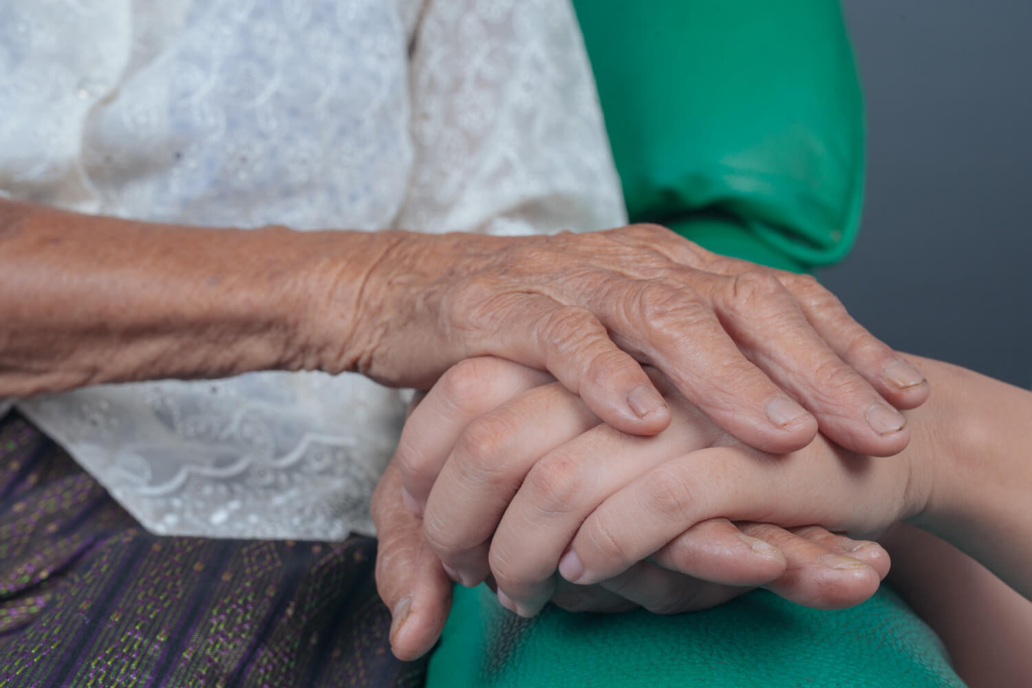 young-woman-holding-elderly-woman-s-hand